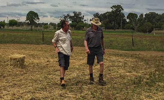 Geoff and Ro talking hay