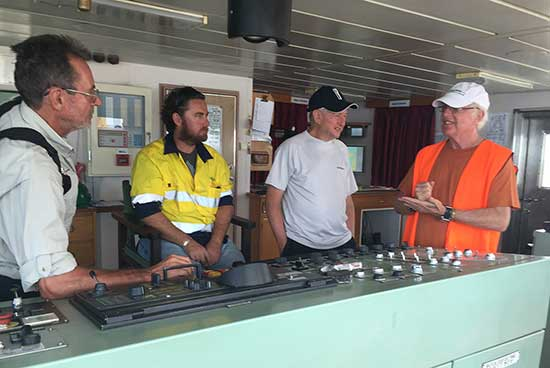 Geoff, Malcolm & Brad chatting with the captain